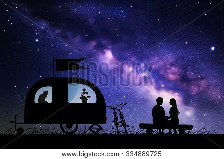 Lovers Near Camper Trailer At Night. Vector Illustration With Silhouette Of Couple Sitting On Log On