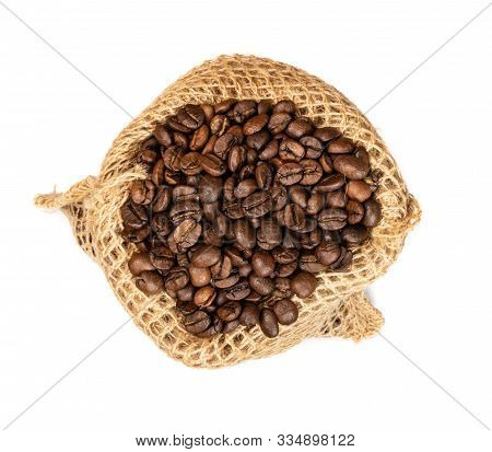 Brown Coffee Beans In Burlap Bag Isolated On White Background