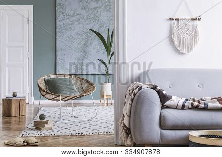 Modern And Bohemian Composition Of Interior Design At Apartment With Gray Sofa, Rattan Armchair, Woo