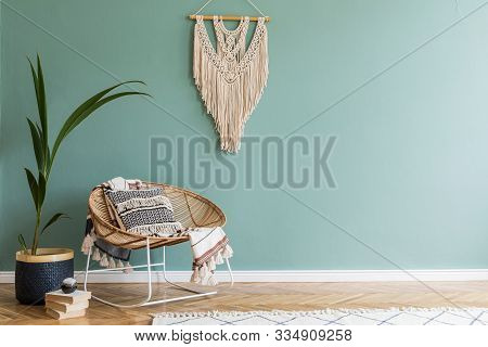 Stylish Minimalistic Interior Of Living Room With Design Rattan Armchair, Tropical Plant In Basket,