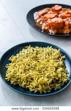Indian Food Jeera Zira Rice Basmati Pilaf Or Pilav With Paneer Butter Tikka Masala / Cheese Cottage