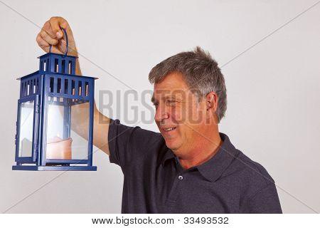 Man Holding A Hand Lantern