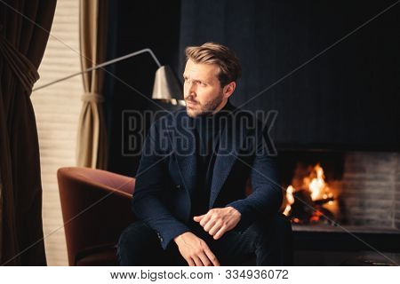 portrait of a handsome man at home
