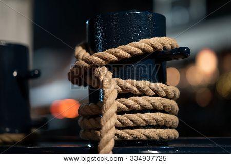 Mooring Knecht. Mooring Bollard. Ropes, Part Of A Ship For Mooring