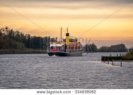 Traditional Steamboat Sailing On The Water With Festive Clothing And Package In Typical Dutch Sinter
