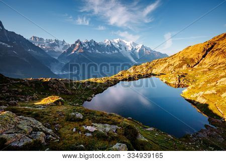 Mighty Mont Blanc glacier with lake Lac Blanc. Location Chamonix resort, Aiguilles Rouges, Graian Alps, France, Europe. Popular tourist attraction. Natural wallpapers. Discover the beauty of earth.