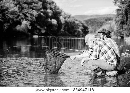 Beautiful Evening Riverside. Men At Riverside Catching Fish. Friends Spend Nice Time At Riverside. E
