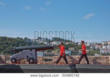 Guards Firing The Noon Day Gun At Castle Cornet, St. Peter Port, Guernsey, Channel Islands