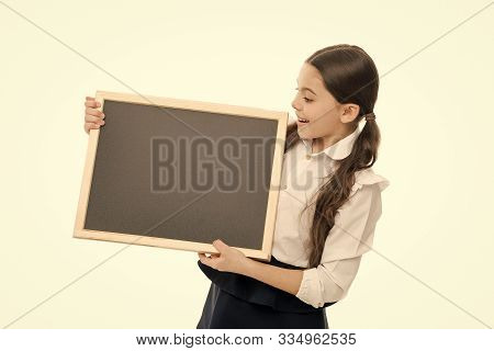The Beginning Of The Lesson. Little Schoolgirl Holding Blank Blackboard For Private Lesson. Small Pu
