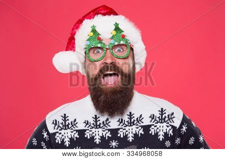 Santa Party. Bearded Man In Christmas Tree Party Glasses. Santa Man With Happy Party Look. New Year