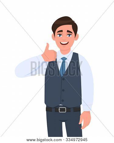 Young Businessman In Waistcoat Showing Thumb Up Gesture. Person Making Symbol Of Like, Agree Or Good