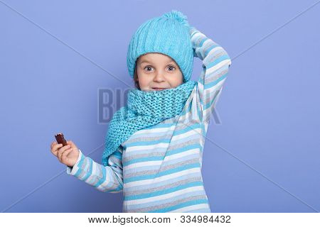 Cute Little Girl Dresses Striped Casual Shirt, Warm Hat With Pom Pom And Scarf, Keeping Hand On Her