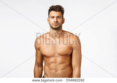 Waist-up Shot Confident Good-looking, Sexy Young Tanned Man, Athlete Standing Naked Torso, Squint, S