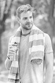 Obey your thirst. Thirsty sportsman. Bearded man holding bottle of drinking water to quench his thirst. Thirst quenching during sports training or fitness activity outdoor. Thirst and dehydration. poster
