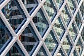 Reflection in the glass facade of a highrise  office building - Sydney, NSW, Australia poster