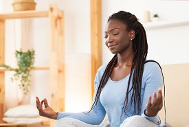 Meditation. Peaceful African American Woman Meditating Sitting In Lotus Yoga Pose In Bed Relaxing At