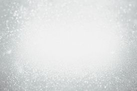 Abstract Bokeh Background. Christmas Glittering Background. Abstract Christmas Grey Color Background