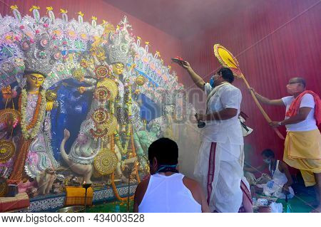 Howrah, West Bengal, India - 25th October 2020 : Goddess Durga Is Being Worshipped By Masked Hindu P