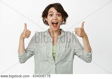 Excited Girl Smiling, Showing Thumbs Up In Approval, Like And Agree, Satisfied With Smth Good, Prais