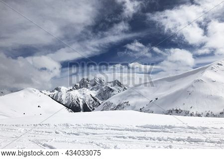 Breathtaking View Of High Peaks Of Winter Mountains, Blue Sky And White Clouds. Wallpaper, Copyspace