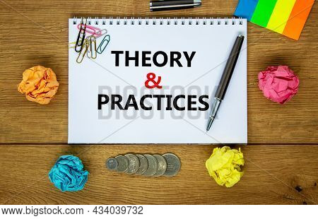 Theory And Practice Symbol. Words 'theory And Practice' On White Note. Wooden Table, Colored Paper,