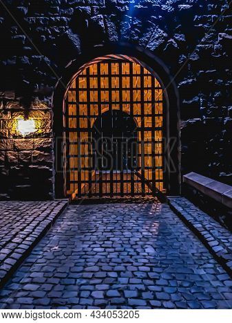 A Gateway Entrance To A Medieval Complex In Nyc During Night Time.