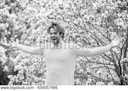 Spring Season. Springtime Concept. Unshaven Man Sniff Bloom Of Magnolia. Man Flowers Background Defo