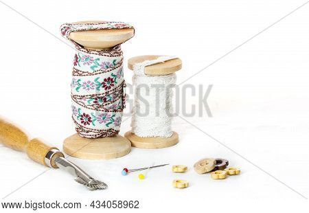 Vintage Lace On The Wooden Bobbin ,ruler ,wood Buttons And Marking Pins On White Background And Copy