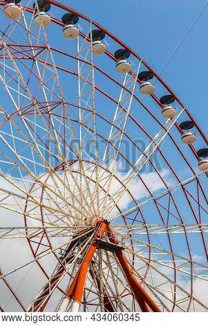 Ferris Wheel Over Blue Sky In The City