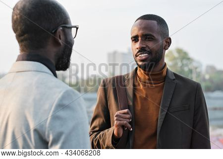 Horizontal Over-the-shoulder Shot Of Handsome Young African American Man Standing In Front Of His Co