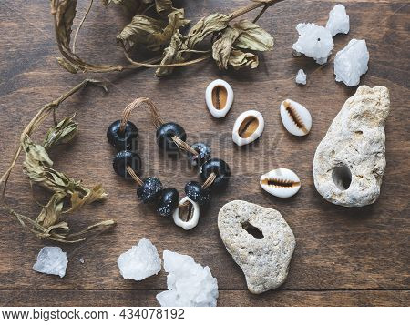 Secret Or Mysterious Ingredients: Talisman, Dry Herbs, Cowrie Shells, Crystals And Rare Stones With
