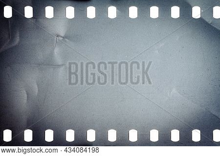 Dusty And Grungy 35mm Film Texture Or Surface. Perforated Camera Film Isolated On White Background.