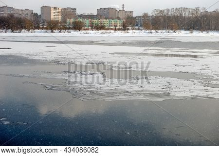 View Of The Volga River And The City Of Kimry On A Spring Day During A Snowfall