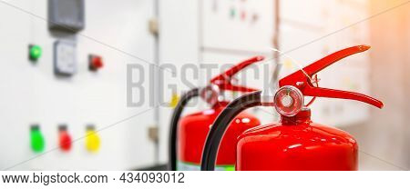 Fire Extinguisher, Close-up Red Fire Extinguishers Tank In Electric Circuit Breaker Main Power Distr