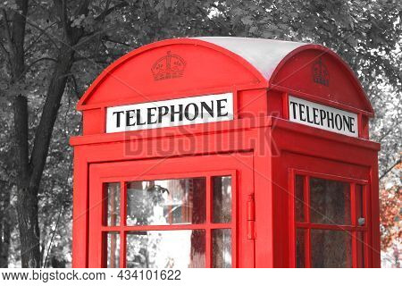Black And White Photo With Red Telephone Booth In Classic English Style On Black And White Backgroun
