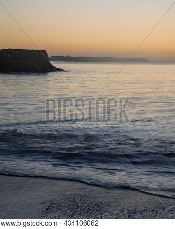 Beautiful Vibrant Late Summer Sunrise Over Pentewan Sands On English Cornwall Coast With Long Exposu