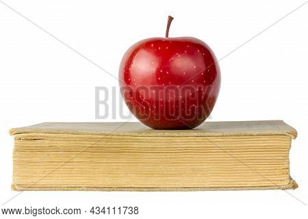 Book With An Apple On A White Background. Encyclopedia Isolated On White Background. Old Book.