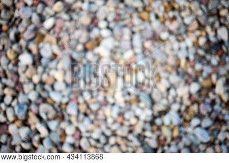 Calm River Beach Shore Stone Abstract Blur. Defocused Abstract Background Of Multicolored Pebbles Or