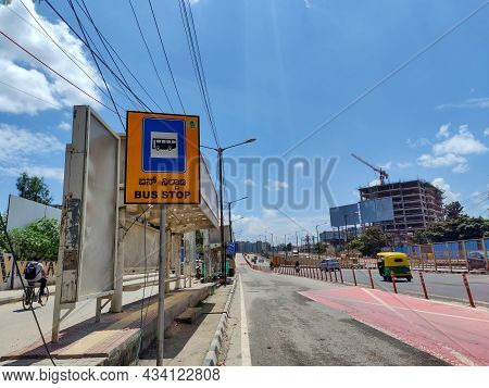 Bangalore, India- September 21st 2021; Stock Photo Of Empty Bus Stop, People Riding Vehicles And Cyc
