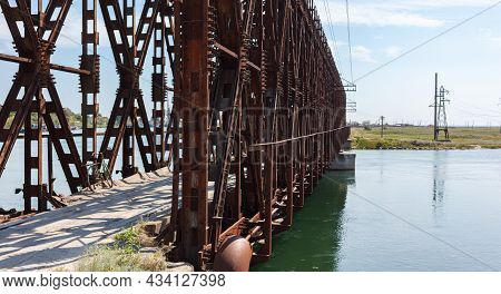 The Metal Structure Of The Old Bridge Across The Strait. Old Railway, Road And Pedestrian Bridge. He