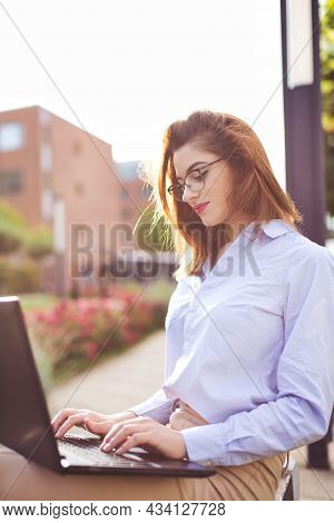 Young Freelancer Caucasian Programmer Woman Working On Laptop In Park