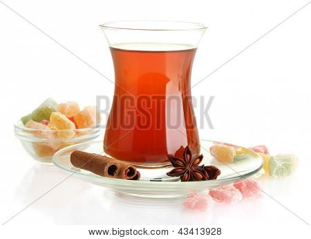 poster of glass of Turkish tea and rahat Delight, isolated on white