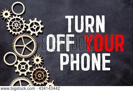 Business Man Pointing The Text: Turn Off Your Phone.