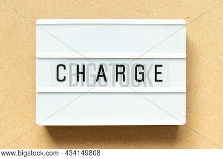 Lightbox With Word Charge On Wood Background