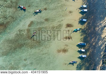 Aerial View Top Down Of Thai Traditional Longtail Fishing Boats In The Tropical Sea Beautiful Beach