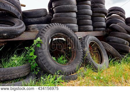 Old Used Damaged Heavy-duty Tires From Agricultural Mechanization Piled, Stacked, On Homemade Dump.