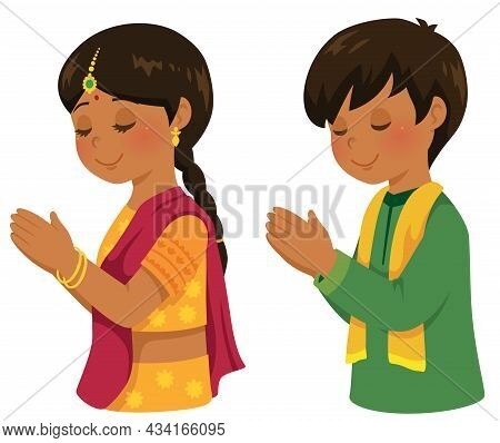 Hindu Boy And Girl In Traditional Indian Outfits Praying On Diwali.
