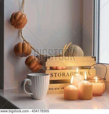 Preparing Your Home For Halloween. A Wooden Pumpkin Box, A Faux Pumpkin Garland, Orange Candles, A C