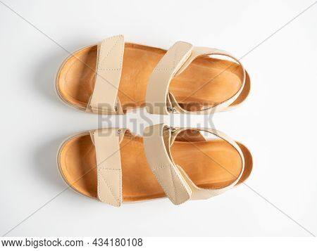 Close-up Of Beige Leather Sandals On A White Background. Pair Of Shoes, Women's Flight Shoes. Top Vi