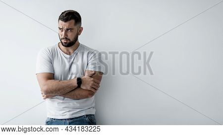 Guilty Sad Unhappy Pensive Millennial Caucasian Handsome Guy With Crossed Arms